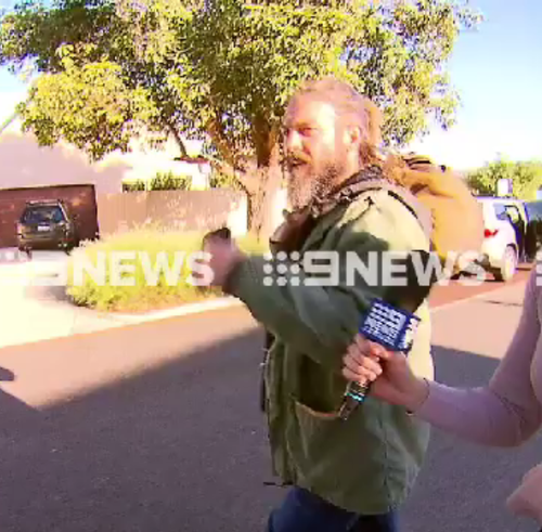 Cousins, who is sporting long hair and beard, refused to answer any questions about his decision to quit. (9NEWS)