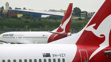 Qantas planes on the tarmac at Sydney Airport.