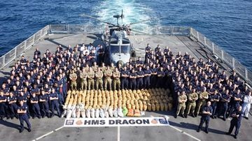 An HMS destroyer has delivered a significant blow to terrorist groups lurking in the Gulf after it intercepted a boat trafficking three tonnes of hashish.
