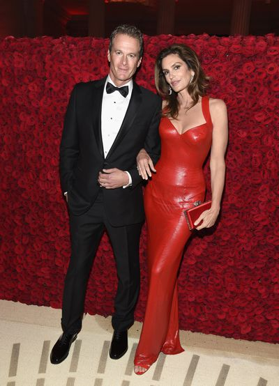 Supermodel Cindy Crawford in Versace and husband Rande Gerber