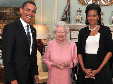 Barack Obama and his wife, Michelle Obama pose with Queen Elizabeth II at a reception at Buckingham Palace