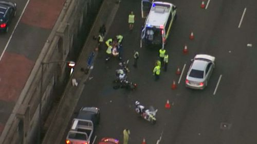 An accident involving a car and a motorcycle on the Sydney Harbour Bridge has caused massive delays for Sydney commuters. (9NEWS)