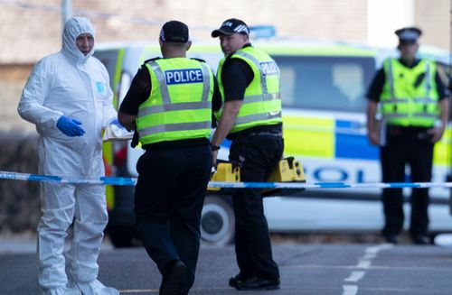 A file photo from last year of police officers on the Isle of Bute in Scotland, after the body of Alesha MacPhail was found.