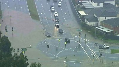 Several major intersections in Sydney's west have been cut off by flooding, stranding thousands of commuters. (9NEWS)