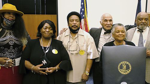 Martinsville Seven family and friends from left, Rose Grayson, Faye Holland, Ron McCollum, James Grayson, Pamela Hairston and Rudy McCollum.