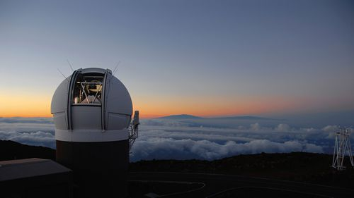 "Observatory on Haleakala, Maui, Hawaii at sunset. In October 2017, the telescope discovered an object from another star system. It was given the name ""Oumuamua,"" which in Hawaiian means a messenger from afar arriving first"