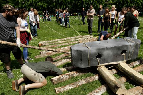 This 2016 file photo shows volunteers recreating how the giant stones were moved to Stonehenge around 3000BC.