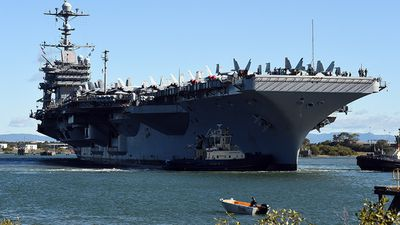 The USS George Washington has docked in Brisbane, delivering her 5,500 strong crew for some much-desired shore leave. Click through the gallery to learn some interesting facts and figures about this Nimitz-class vessel. (Image source: AAP)