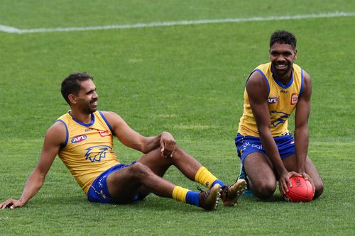 Liam Ryan chats to teammate Lewis Jetta during training on Monday in Perth before the flight to Melbourne for the Grand Final.