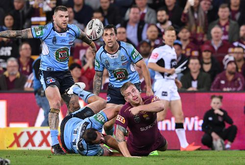 NSW players take on their Queensland counterparts in the State of Origin decider last year. (AAP)