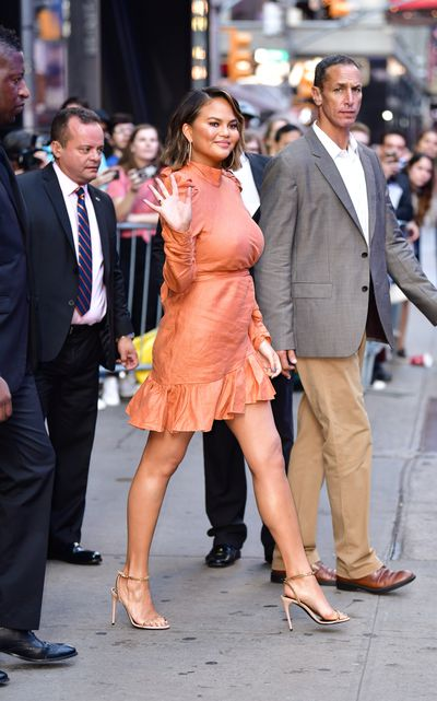 The TV star stepped out in a bright coral mini dress while visiting Live with Kelly and Ryan on the same day.
