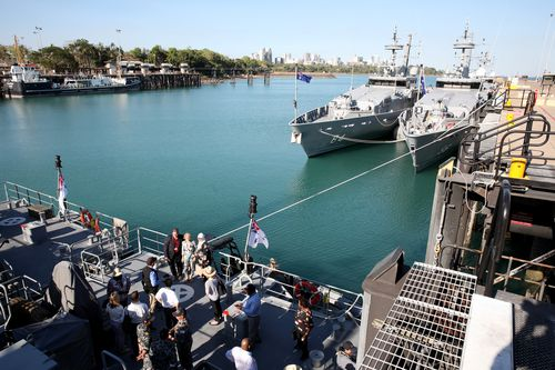 Mrs Bishop has pictures taken with delegates onboard HMS Maitland, an Armadale class patrol boat stationed at HMAS Coonawarra station in Darwin. Picture: AAP