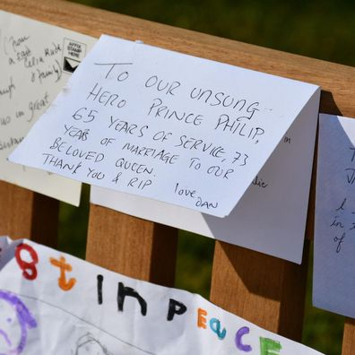 Tributes left for Prince Philip outside various palaces have been moved to Marlborough House Gardens by Royal Parks staff