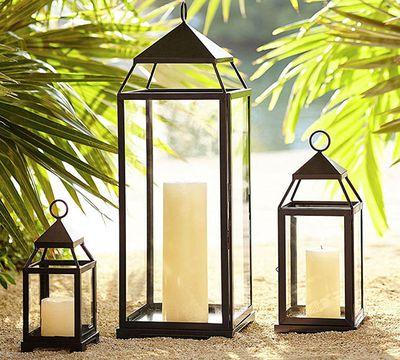 "Malta lantern $30.80,<a href=""http://www.potterybarn.com.au/malta-lantern-bronze-finish"" target=""_blank"">Pottery Barn</a>."