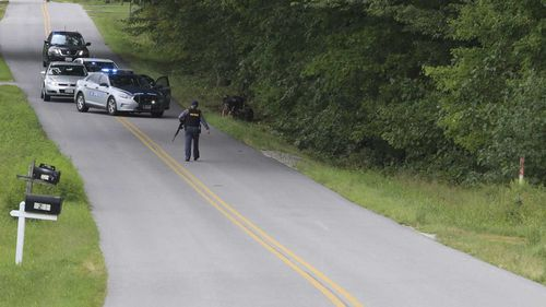 Police swarmed on the tiny Virginia community of Keeling after the killings.