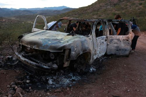 A man has been arrested in connection with last year's massacre of nine Mormon American-Mexican citizens on a remote dirt road in northwestern Mexico. In this photo, relatives of the slain examine one of the three vehicles that were attacked in Mexico's Sonora state.
