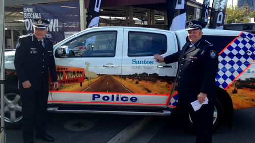 Queensland police minister defends mining firm logo on vehicles