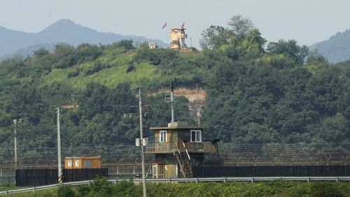 Military guard posts of North Korea, rear, and South Korea, bottom, are seen in Paju, near the border.