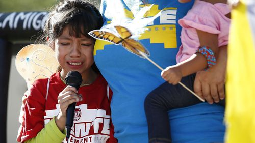 Akemi Vargas, 8, cries as she talks about being separated from her father during an immigration family separation protest in front of the Sandra Day O'Connor U.S. District Court building in Phoenix. (AP)