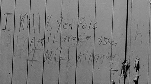 A message scrawled in pencil or crayon appeared on a barn door not far from where April Tinsley's body was found, the FBI said. Image: CNN