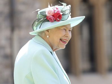 Britain's Queen Elizabeth smiles after awarding Captain Sir Thomas Moore his knighthood during a ceremony at Windsor Castle.