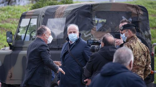 Anti-mafia Prosecutor Nicola Gratteri, left, stands by military personnel outside a specially constructed bunker on the occasion of the first hearing of a maxi-trial against more than 300 defendants of the 'ndrangheta crime syndicate