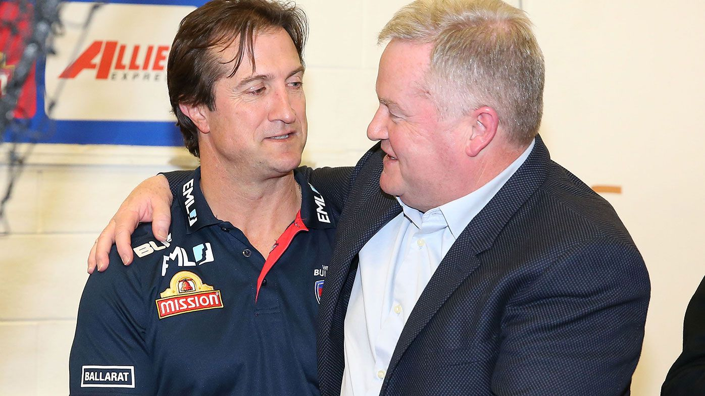 Luke Beveridge, coach of the Bulldogs is congratulated by Western Bulldogs president Peter Gordon