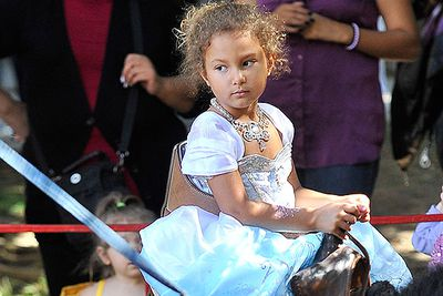Halle Berry's daughter Nahla Aubry rides a horse dressed as a princess as she and dad Gabriel Aubry attend a Halloween festival.