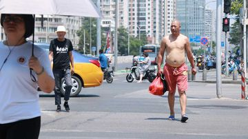 China is taking a tougher stand on male shirtlessness.