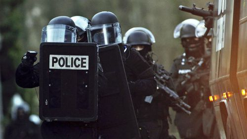 French police officers patrol in Longpont, north of Paris, in search of the Charlie Hedbo gunmen. (AAP)