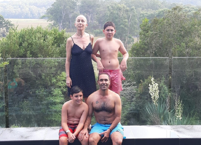 Yoav and Elaine with their boys swimming