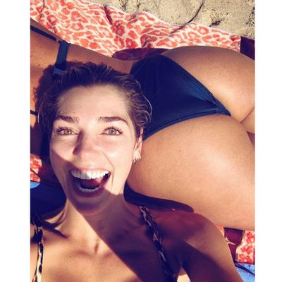 "Model Ashley Hart with her pal Melanie Rose Moylan's ""beach pillow"""