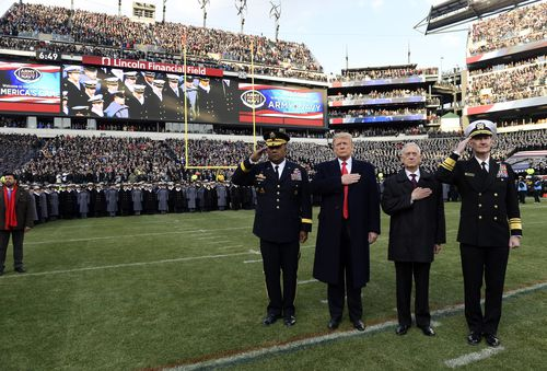 Mattis, pictured with Trump listending to the national anthem at an American football match, is seen as a stabilising force in the administration.