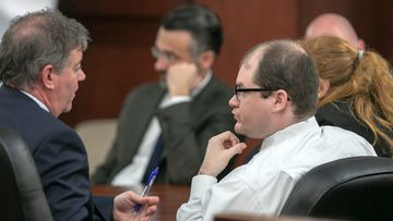 Timothy Jones Jr. talks with his lawyer, Boyd Young