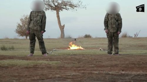 The graphic video purportedly shows two Turkish soldiers being burned alive.
