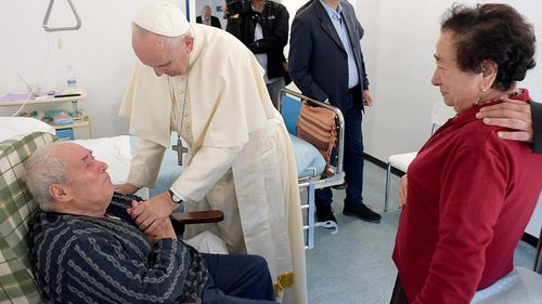 Pope Francis greets A patient at San Raffaele Borbona health assistance facility in Rieti. (AAP)