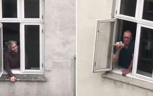Danish residents in lockdown sing 'You've got a friend' from windows