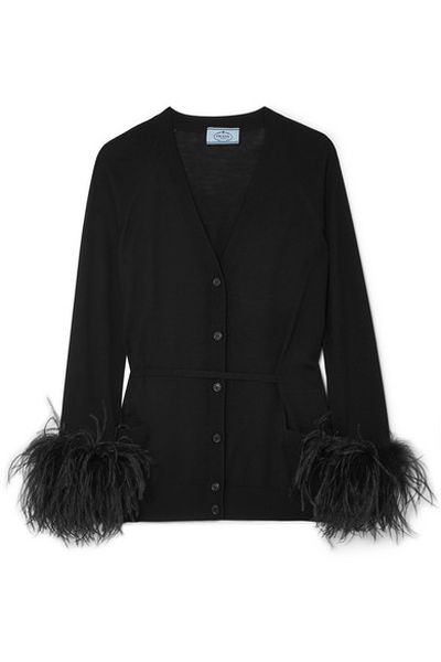 "<a href=""https://www.net-a-porter.com/au/en/product/1000963/Prada/feather-trimmed-cardigan"" target=""_blank"" title=""Prada Feather-Trimmed Cardian, $2,149"">Prada Feather-Trimmed Cardian, $2,149</a>"