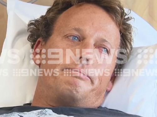 Lee Jonsson told 9News he used his surfboard to beat the shark away before he swam into shore and took himself to hospital.