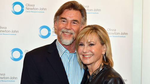 Newton-John with her husband John Easterling. (AAP)