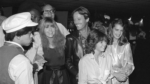 Jane (left) and Peter Fonda (centre), Kristy McNichol (bottom) and Brooke Shields (right), arrive at Halloween Celebrity Disco Dance benefit in Los Angeles, November, 1978.