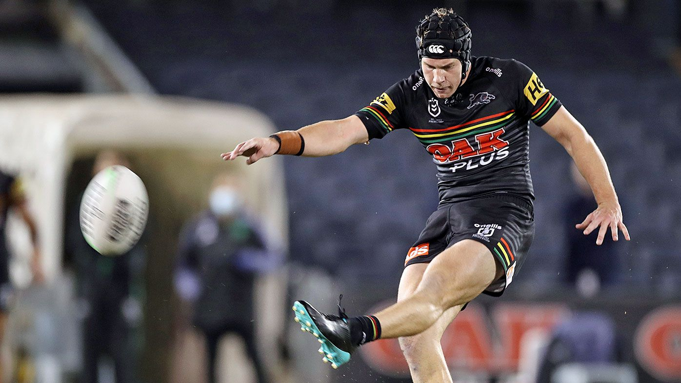 Matt Burton of the Panthers misses a field goal during the round three NRL match
