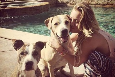 Kaley loves her dogs so much that her Instagram username (@normancook) is even named after Norman! She's smooching him in this pic while Shirley hangs out nearby.