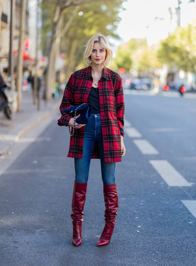German blogger Lisa Hahnbueck wearing Saint Laurent shirt, JBrand jeans, Chanel bag and red Zara boots, Paris Fashion Week