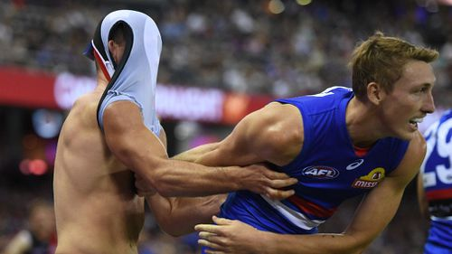 Moments after the alleged biting, McKenna tussled with Bulldogs player Bailey Dale. (AAP)