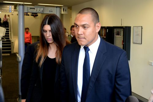 Olympian Geoff Huegill and his wife Sara Hills leave Waverley Court in 2014 after Mr Huegill was charged with possessing cocaine at Randwick Racecourse. Picture: AAP