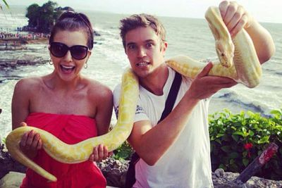 @nicwestaway: First time holding a snake! Epic!! #BaliAdventur