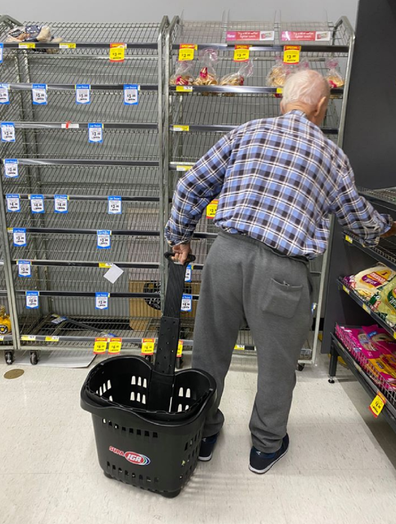 Elderly man searching for bread at IGA Hurstville.