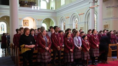Pupils of Roncalli College at the Mass for crash victims at Sacred Heart Basilica, Timaru.