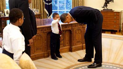 Five-year-old Jacob Philadelphia asked if the president's hair was like his. Mr Obama then told Jacob to feel for himself. (Flickr/White House)